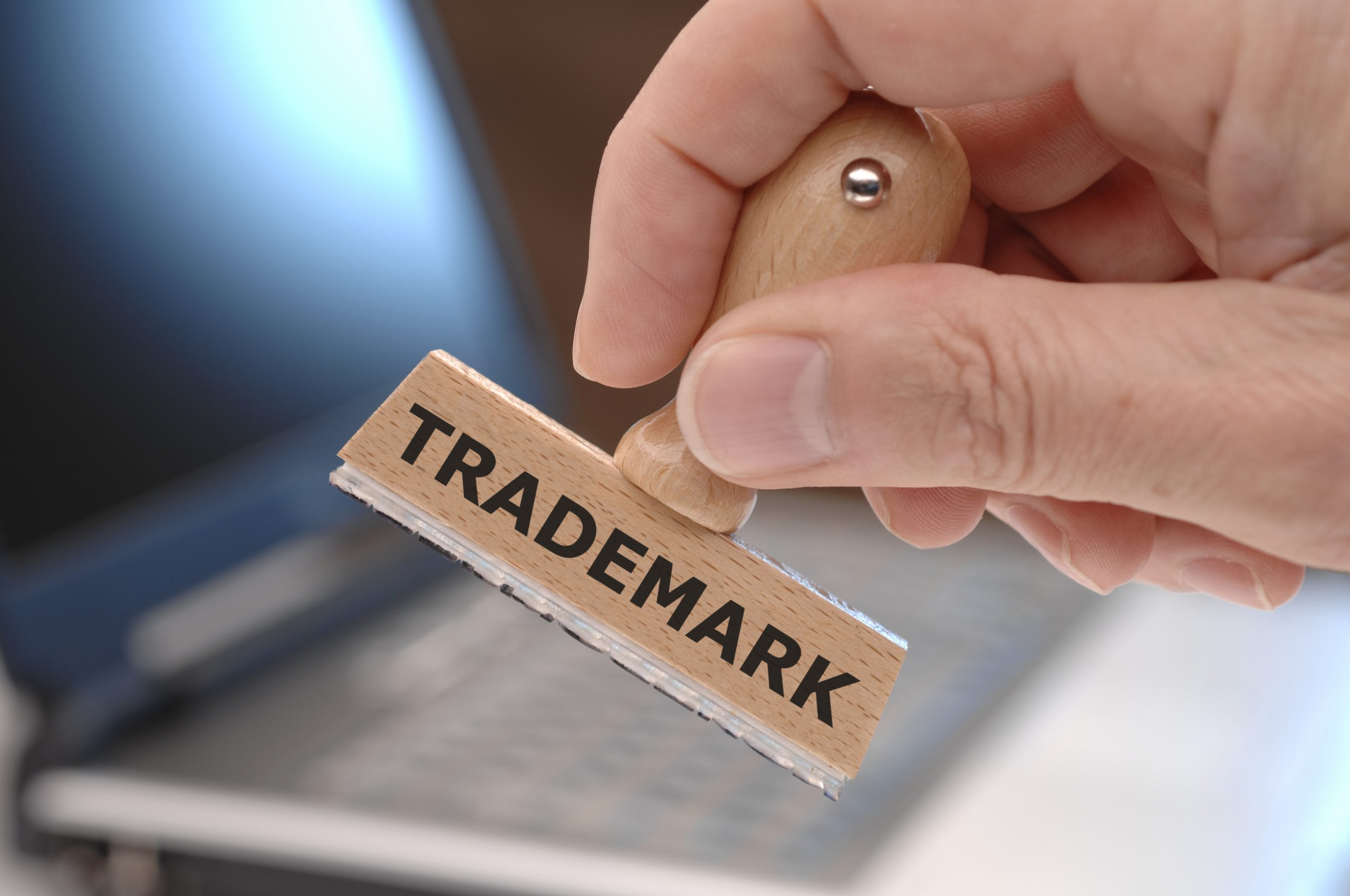 trademark stamp in front of laptop